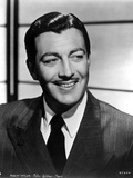 Robert Taylor Grinning in Suit