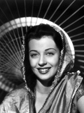 Gail Russell smiling in Shawl