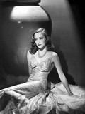 Nina Foch Seated in Silk Dress