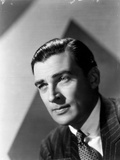 Walter Pidgeon posed in Suit