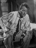 John Wayne rugged sitting down