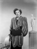 Myrna Loy posed in Furry Coat