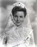 Rhonda Fleming smiling in Veil