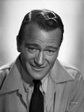 John Wayne in coat and tie
