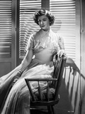 Myrna Loy posed on Chair