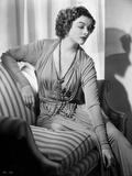 Myrna Loy posed on Couch