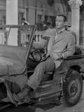 John Wayne in automobile