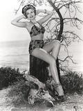 Ann Miller sitting in Lingerie
