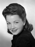 Anne Baxter smiling and posed