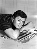John Saxon Leaning on Table