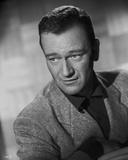 John Wayne wearing a Suit
