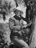 John Wayne with gun and hat
