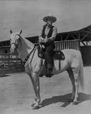 John Wayne on white horse