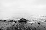 Nostalgic Sea Waves Hitting in Rock in the Center Black and White  far Horizon