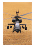 AH-64A Apache flies over fields