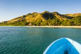 Blue Boat Cruising Through the Yasawa  Fiji  South Pacific