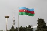 Azerbaijan  Baku an Azerbaijan Flag Waves Near a Memorial Flame and the Baku Tv Tower
