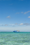 Fishing Boat in the Turquoise Waters of the Blue Lagoon  Yasawa  Fiji  South Pacific