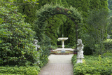 Maryland  Beautiful Sculptures and Hedges Surround a Fountain in an Elegant Garden