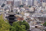 The Five-Tiered Pagoda of To-Ji  Looks Out over the Modern City of Kyoto  Japan