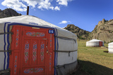 Tourist Ger Camp in Front of Rocky Outcrop in Fine Weather in Summer  Central Mongolia  Mongolia