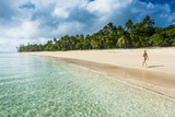 Woman Walking on a Palm Fringed White Sand Beach in Ha'Apai Islands  Tonga  South Pacific