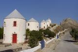 Row of Old Windmills on Pitiki Hill Below Panteli Castle  Greek Islands