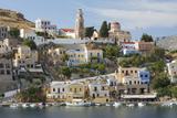 View over Harbour to Colourful Houses and Church  Dodecanese Islands