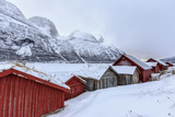 Typical Wooden Huts in the Snowy Landscape of Lyngseidet  Lyngen Alps  Tromso Lapland  Norway