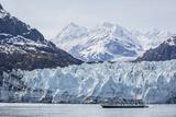 A Tourist Ship Explores the Lamplugh Glacier in Glacier Bay National Park and Preserve  Alaska