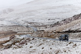 A Four Wheel Drive Vehicle Negotiates a Road Through a Wintry Landscape in Elan Valley Area  Wales