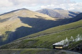 Steam Engine and Passenger Carriage on Trip Down Snowdon Mountain Railway  Gwynedd  Wales