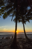 People by Palm Trees at Sunset on Playa Hermosa Beach  Santa Teresa  Costa Rica