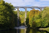 Narrowboat Crossing the River Dee in Autumn on the Pontcysyllte Aqueduct  Denbighshire