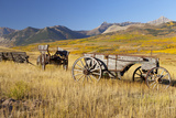 Old Horse-Drawn Wagons with the Rocky Mountains in the Background  Alberta  Canada