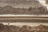 Brick Workers Amongst Hand Made Bricks  Rajasthan  India