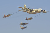 A Royal Moroccan Air Force Kc-130 Refueling a Pair of F-5 Aircraft