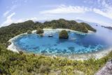 Rugged Limestone Islands Surround a Lagoon in Raja Ampat