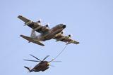 An Israeli Air Force Kc-130H Karnaf Refuels a Ch-53 Yasur Helicopter