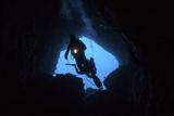 Scuba Divers Explore a Cave Near the Island of Sulawesi  Indonesia