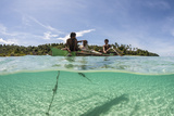 Young Villagers Fish Off their Outrigger Near a Remote Island in Indonesia