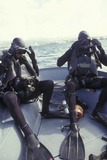 Navy Seals Combat Swimmers Donn their Equipment in a Utility Boat