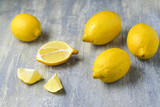 Whole and Sliced Lemons on Grey Subsoil