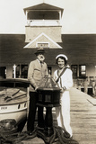 Old Man and Woman in Sailor Outfit Posing on the Dock