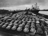 Volkswagen Beetles Lined Up on the Dock