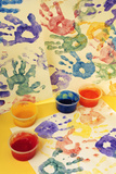 Colorful Handprints and Cups of Paint