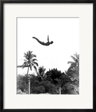 1940s Man Poised Midair Arms Out Jumping from Diving Board into Pool