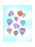 Multiple Bright Colored Hot Air Balloons Flying Through Sky