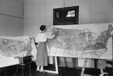 Women Applying Color to a Large Detailed Map of the Continental United States
