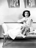 Kay Francis  Modeling White Crepe Lounging Pajamas with a Paisley Sash  Ca Mid-1930s